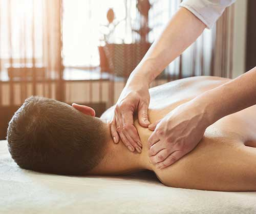 woman receiving SET therapy massage