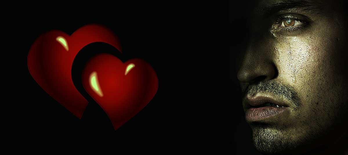 man crying over broken heart