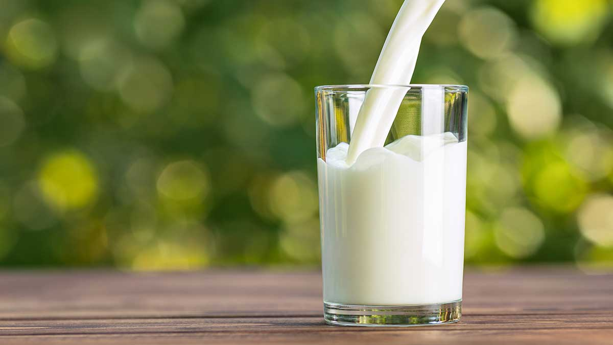 milk pouring into a glass